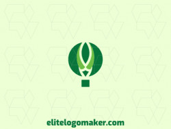 Abstract company logo in the shape of a balloon combined with a bird head composed of leaves with green colors.